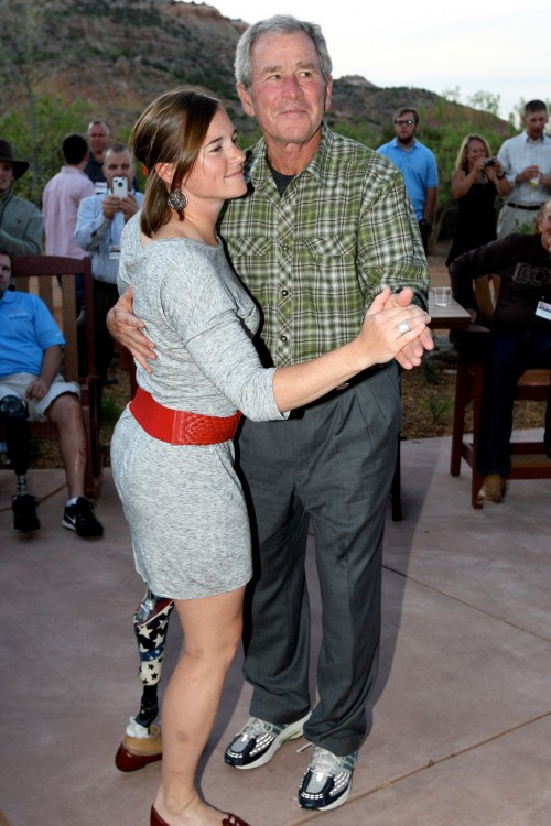 W. two-stepping with heroine Melissa Stockwell, the first woman ever to lose a limb in combat, at a Randy Rogers Band concert for the Warrior 100K. TFM.