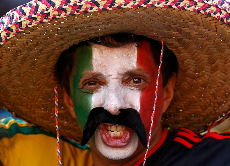 A Mexican soccer fan poses before the opening ceremony of the 2010 World Cup at Soccer City stadium in Johannesburg