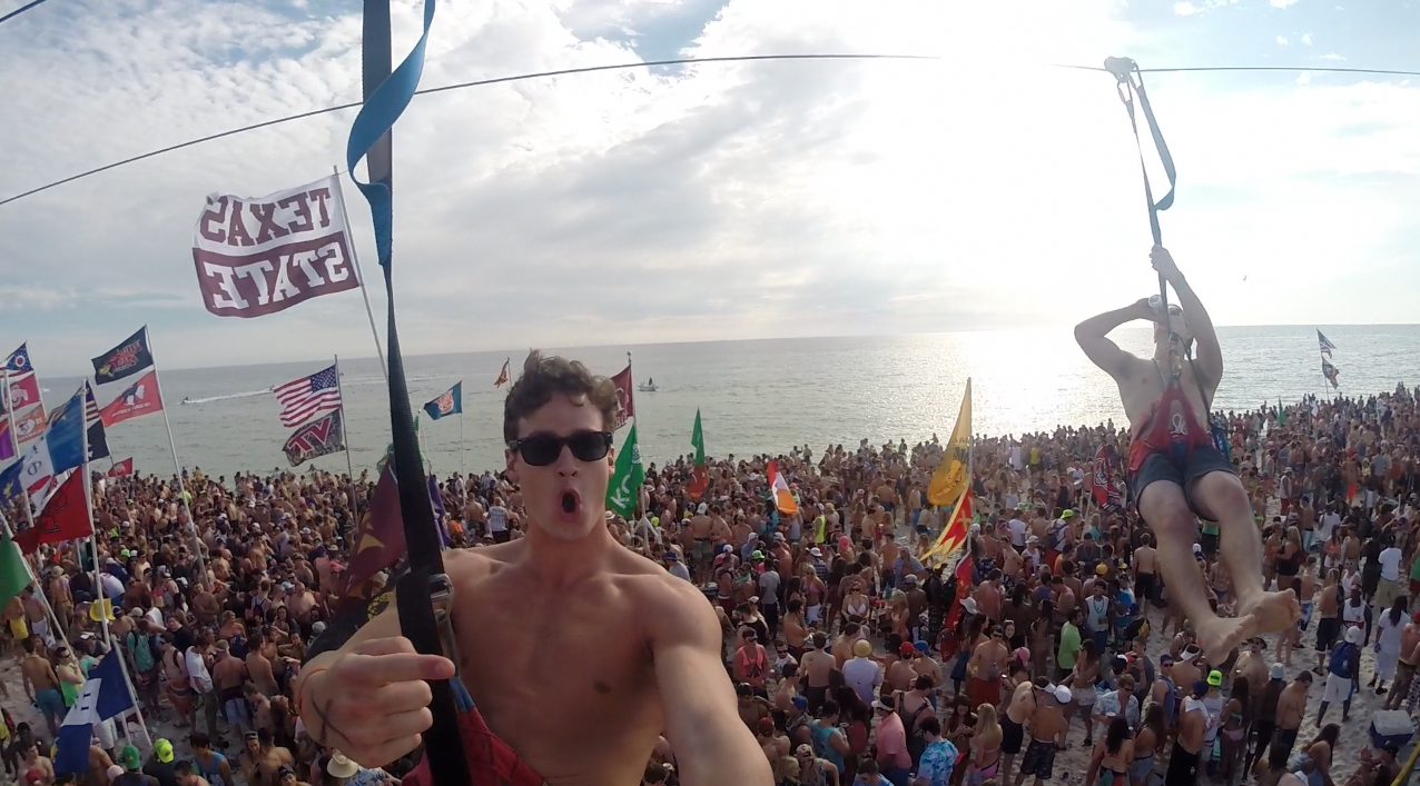 Zipline beer chugging above the crowd. TFM.