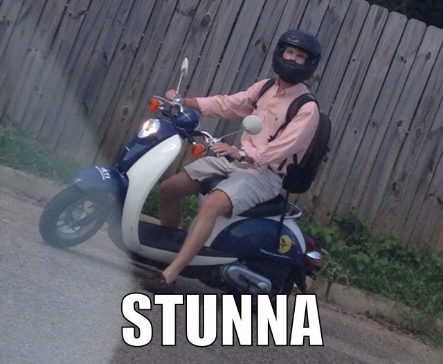 Stuntin' on the scooter.